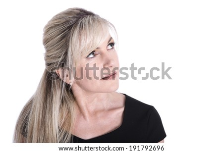Portrait of mature beautiful blond business woman face looking up.