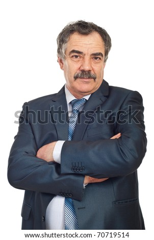 Portrait of mature business man standing with arms folded isolated on white background - stock photo