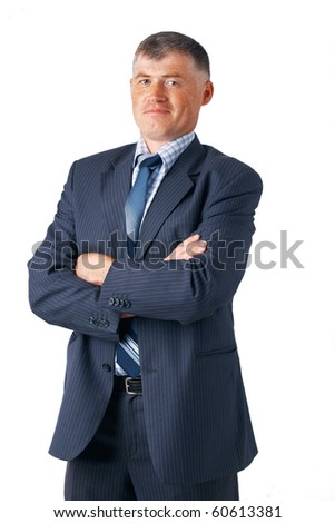 Portrait of mature business man with folded hands against white background