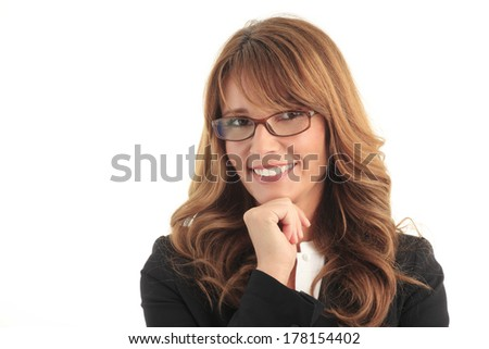 Portrait of mature businesswoman standing against white background.