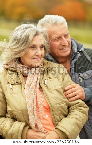 Portrait of  mature couple in the autumn park