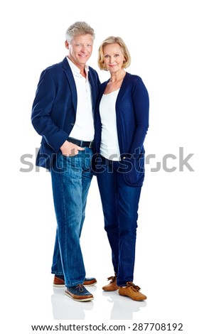 Portrait of mature couple standing together posing in casuals over white background - stock photo