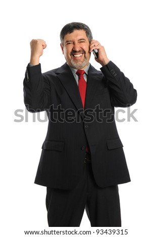 Portrait of mature Hispanic businessman celebrating while using cell phone isolated over white background