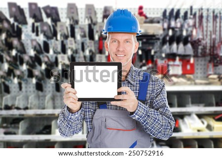 Portrait Of Mature Male Worker Holding Digital Tablet - stock photo