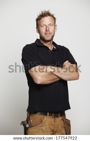 Portrait of mature man with arms folded, studio - stock photo