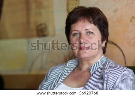 Portrait of mature woman at a cafe - stock photo