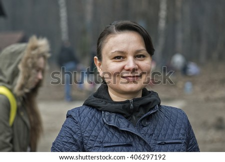 Portrait of mature woman in park.  - stock photo