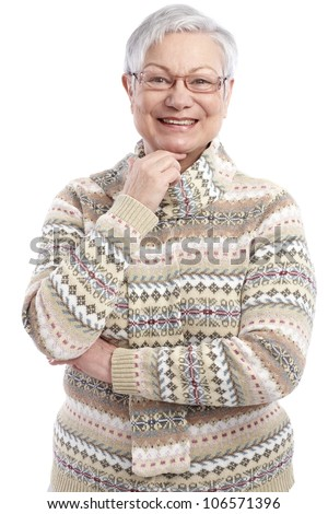 Portrait of mature woman in sweater smiling, looking at camera. - stock photo