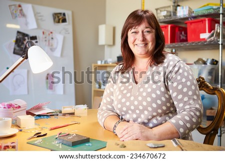 Portrait Of Mature Woman Making Jewelry At Home - stock photo
