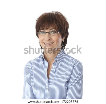Portrait of mature woman smiling, wearing glasses, looking at camera. - stock photo