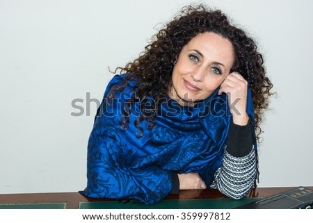 Portrait of mature woman. With curly hair, blacks or dark, green eyes, on white or clear. - stock photo