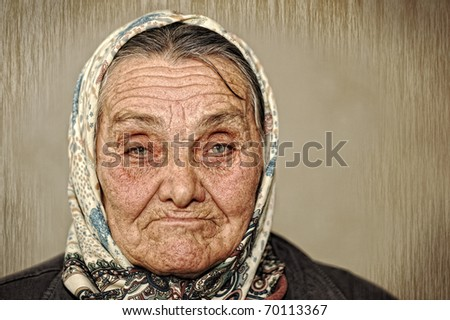 Portrait of mature woman with green eyes and scarf on head - stock photo