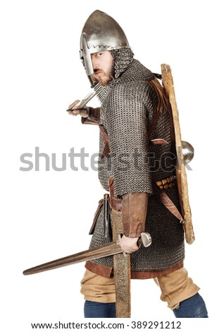 portrait of medieval slavic soldier looking at camera, with helmet, hauberks, sword, shields and axe, isolated on white background. historical concept.