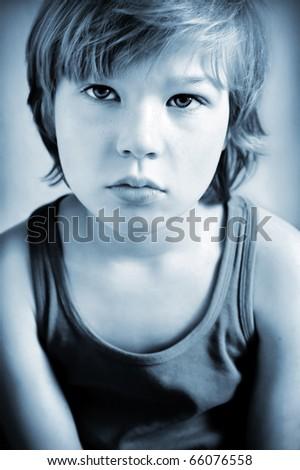 Portrait of melancholic boy, toned in selenium tone - stock photo