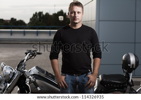Portrait of mid aged man with motorcycle