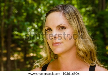 Portrait of middle-age woman outdoors - stock photo
