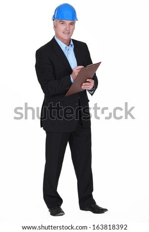 portrait of middle-aged architect holding clipboard - stock photo