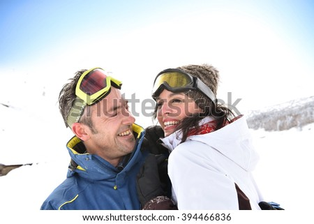 Portrait of middle-aged couple at ski resort - stock photo