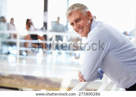Portrait of middle aged man in office - stock photo