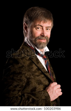 Portrait of middle aged man on a black background - stock photo