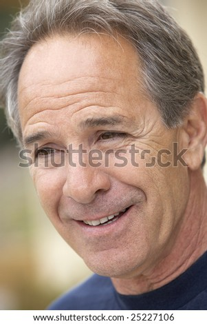 Portrait Of Middle Aged Man Smiling - stock photo