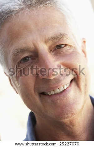 Portrait Of Middle Aged Man Smiling At The Camera - stock photo