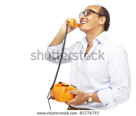 portrait of middle aged man talking using a vintage telephone over white background - stock photo