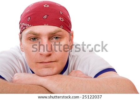 Portrait of middle-aged man wearing pirate headscarf isolated - stock photo
