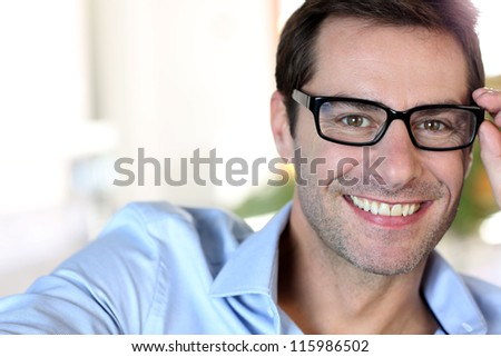 Portrait of middle-aged man with eyeglasses - stock photo