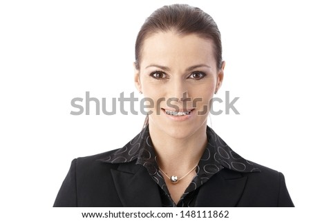 Portrait of middle-aged smiling businesswoman looking at camera confidently. - stock photo