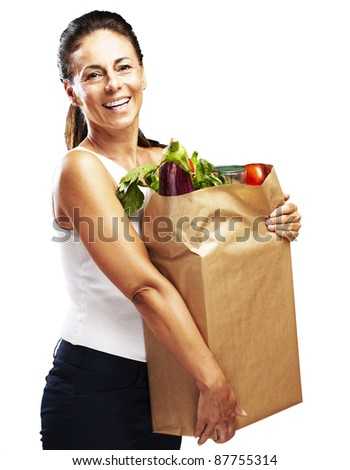 portrait of middle aged woman holding the purchase over white background - stock photo
