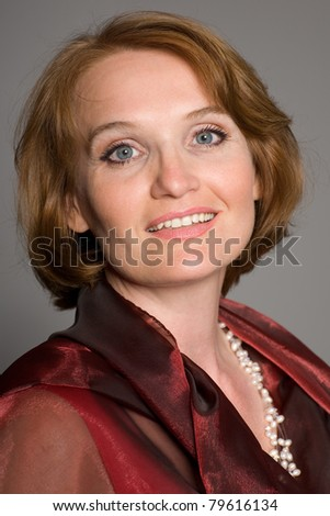 Portrait of middle-aged woman in the red. - stock photo