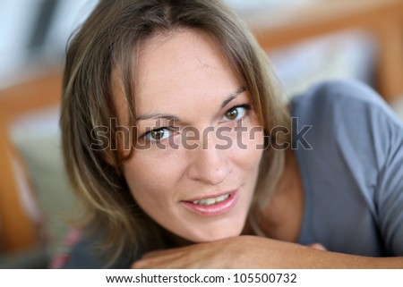 Portrait of middle-aged woman relaxing in sofa