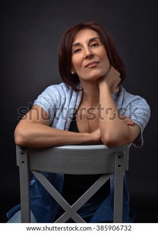 portrait of middle aged woman , studio shot - stock photo