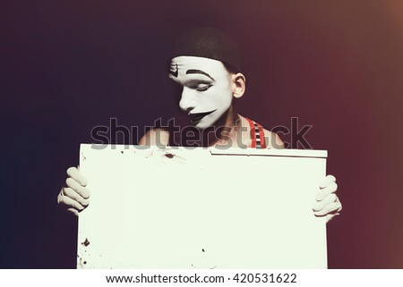 Portrait of mime holding white dirty sheet in hands
