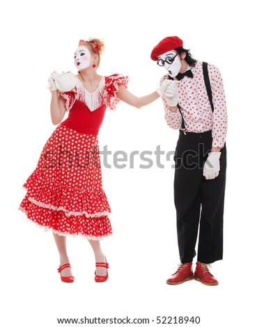 portrait of mimes in love. man kissing womans hand. - stock photo