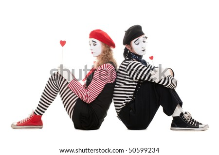 portrait of mimes. sad lovers sitting on the floor with red small hearts. isolated on white - stock photo