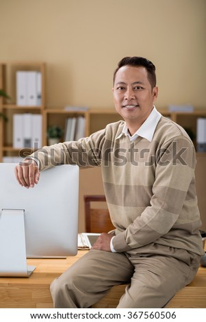 Portrait of mixed-race office manager smiling at camera