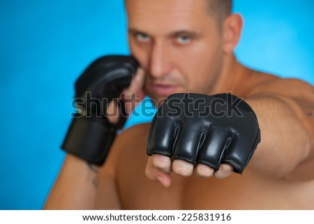 portrait of mma fighter in boxing pose - stock photo
