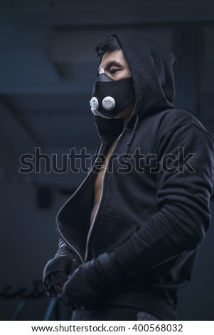 portrait of mma fighter in gym - stock photo