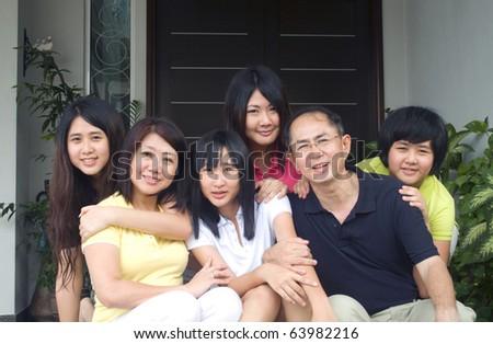 portrait of modern asian family - stock photo
