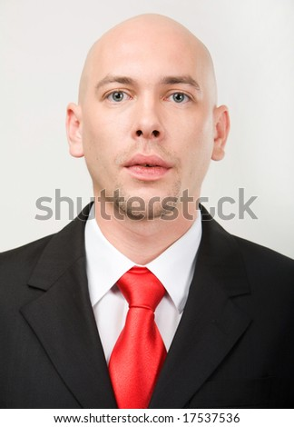 Portrait of modern entrepreneur looking at camera - stock photo