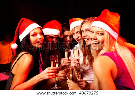 Portrait of modern young people enjoying themselves at Christmas party - stock photo