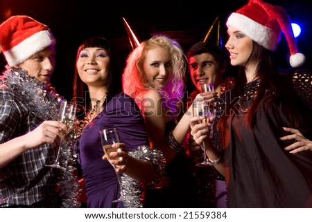Portrait of modern young people enjoying themselves at New Year party