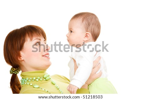 Portrait of mom holding baby in hands