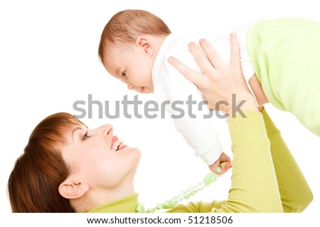 Portrait of mom holding baby in hands - stock photo