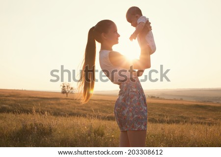 Portrait of mother and baby - stock photo
