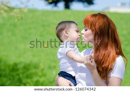 Portrait of mother and baby boy outdoors in park