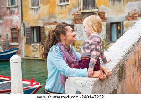 Portrait of mother and baby girl in venice, italy - stock photo