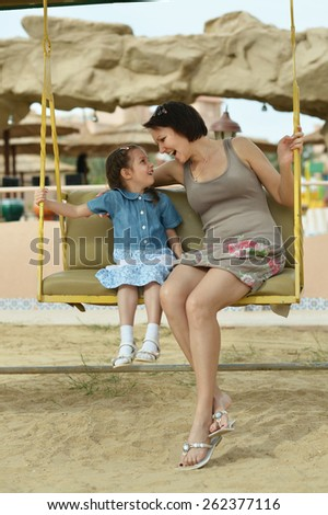 Portrait of Mother and Daughter having fun outdoors - stock photo
